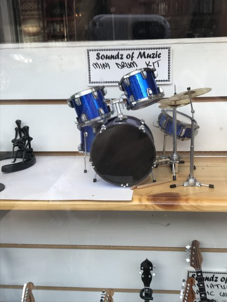 miniature drum set in store window