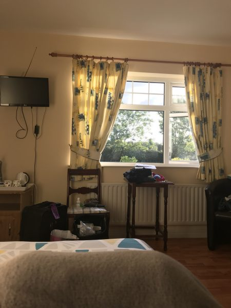 The Kilkenny B & B had yellow curtains, quilts, and was cheery