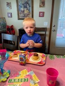 Eian eating his cupcake