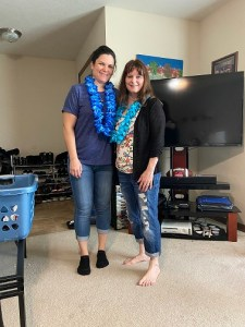 My precious, beautiful daughter Heather and me with a colored lei