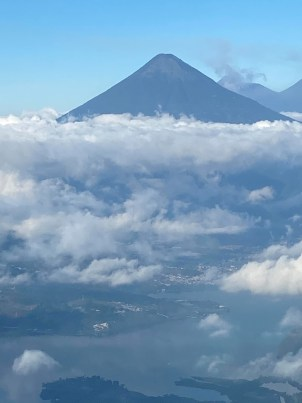 View of volcano in the clouds from my plane