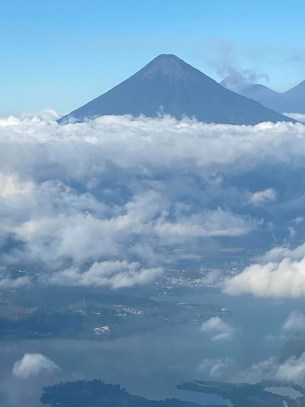 View from my plane Volcano in the clouds Guatemala