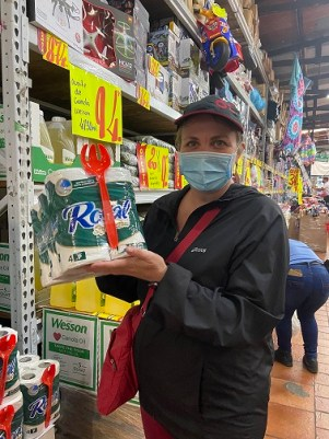Kim with random taped stuff at grocery store