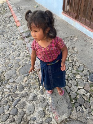 Maria, a little girl begging