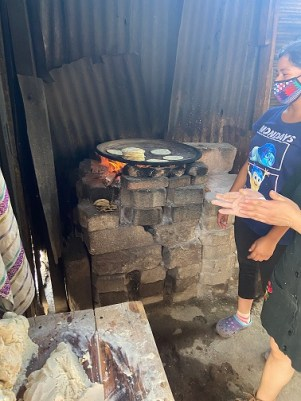Guatemalan woman making tortillas