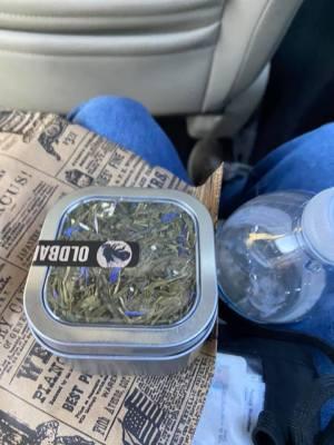 Leah's peach mango tea she bought (in a tin can).