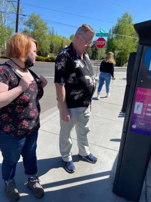 Ray and Leah trying to figure out the parking machine