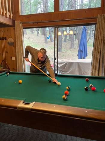 Ray playing pool, acting like Fast Eddie in the movie, The Color of Money