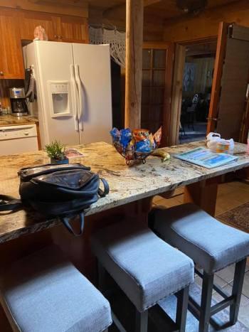Breakfast bar & stools in open kitchen.