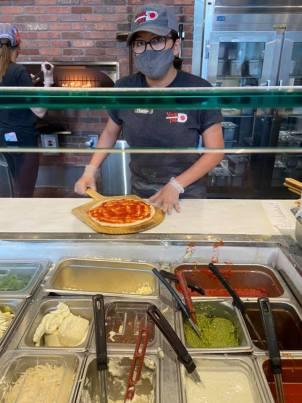 Staff making my pizza
