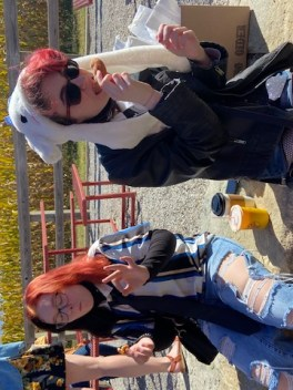 Our granddaughters Violet & Annabelle at the Louisburg Cider Mill eating cider doughnuts and drinking apple cider