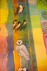 "Icons on the strips, ""Snowy Owl,"" ""Puffins,"" ""Osprey,"""