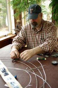 Armature. Assistant Tim Kelleher wiring hooks.