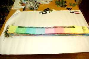 "Transporting ""Circle of Life."" Wrapping the number-ordered, rainbow strips."