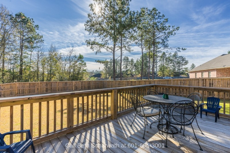 Kingsmill Hattiesburg MS Real Estate Properties for Sale - Enjoy the fresh air and country views on the deck of this move-in ready Hattiesburg MS home.