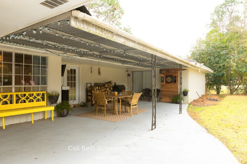 Hattiesburg MS Real Estate Properties for Sale - Enjoy the wonderful view of open skies and feel the clear, crisp air as you relax on the backyard porch of Hattiesburg home.