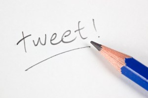 Pencil with the word TWEET on a piece of paper