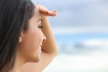 Close up of a beautiful woman looking at the horizon