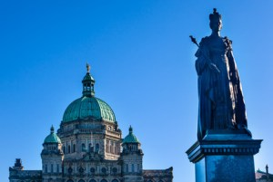 Provincial Capital Legislative Parliament Buildiing Queen Victoria Statue Victoria British Columbia Canada.  Gold Statue top of dome is of George Vancouver.