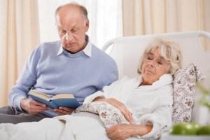 Husband reading ill wife book