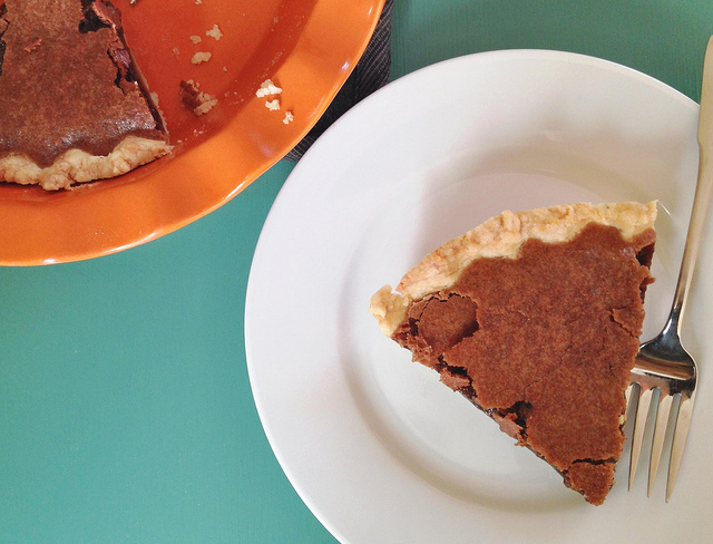 a wedge of chocolate chess pie