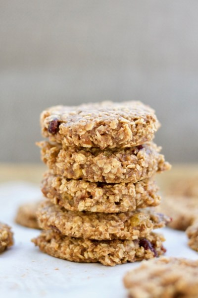 A stack of breakfast cookies made with oats, almond butter, raisins, cranberries, and nuts.