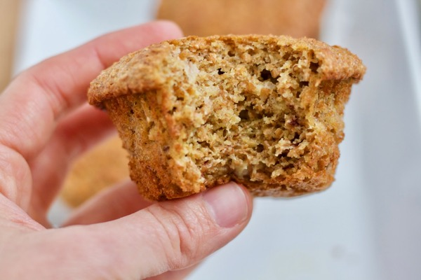 whole wheat banana bran muffin showing the light, tender inside and the toasty brown outside
