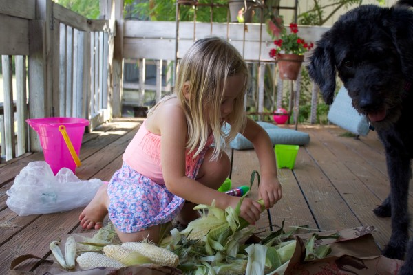 my daughter peeling corn for dinner