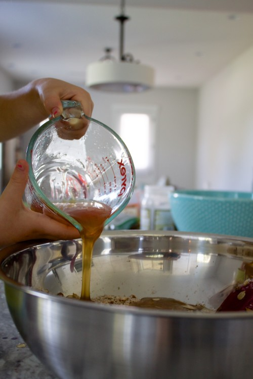 adding honey and coconut oil to paleo granola
