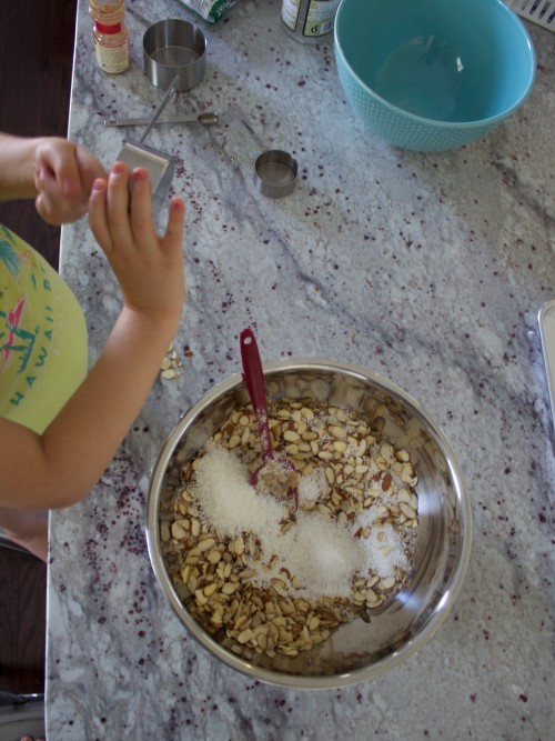 mixing nuts and coconut for paleo granola