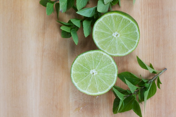 sliced lime and basil leaves for pan-seared fish with lime and basil