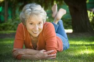 happy-woman-outside-on-grass
