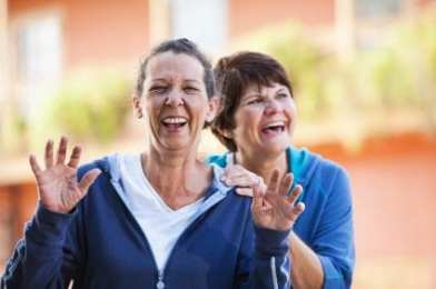 two women laughing with happiness