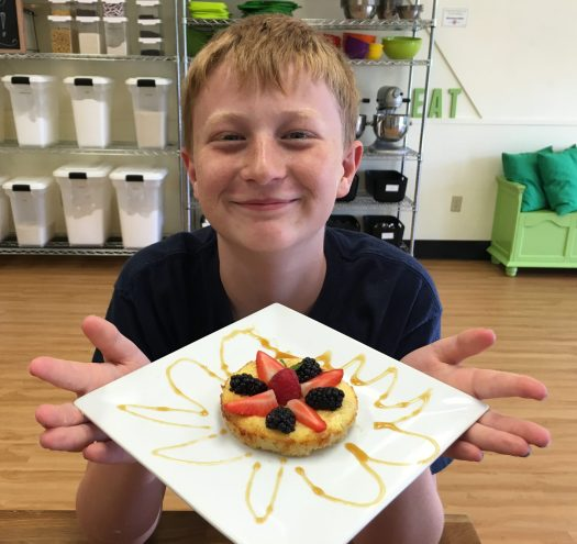 Kid showing off what he made at Summer Camp