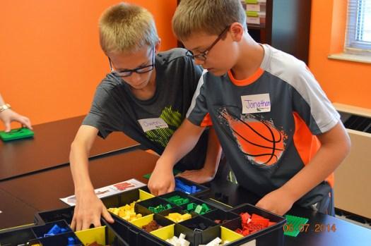 2 boys building with legos