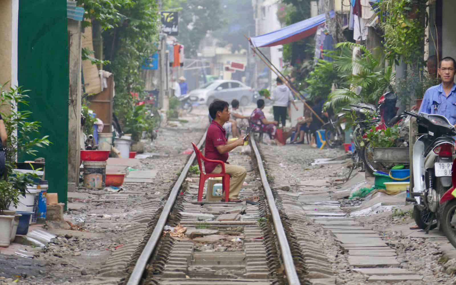 Sitting Reading railway Hanoi Vietnam betternotstop