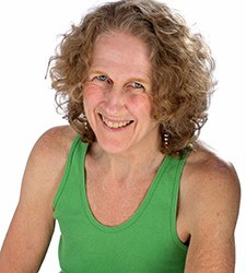 Picture of smiling woman weraing green tank top