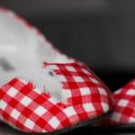 Broken red shoes