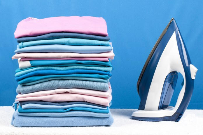 neatly folded shirts - how to organize your closets