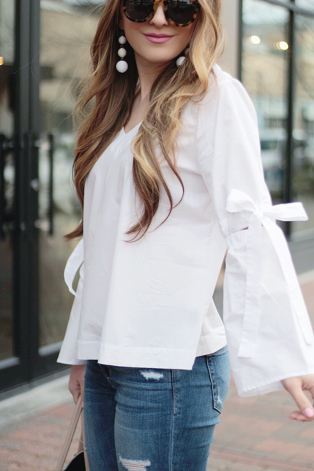 bell sleeves and bow detail top rachel puccetti between two coasts