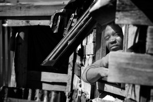 Man at his window in Masipumelele Township near Cape Town