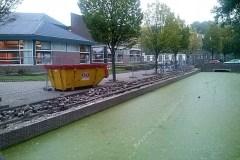 Toplaag vernieuwd muurtje Oude Watering
