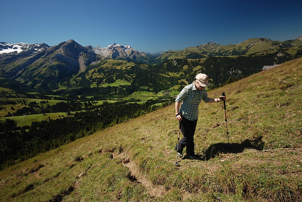 woman hiking up the mountain