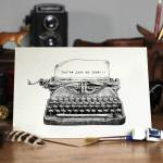 Valentines Day card of a black and white drawing of an old style typewriter on a wooden desk