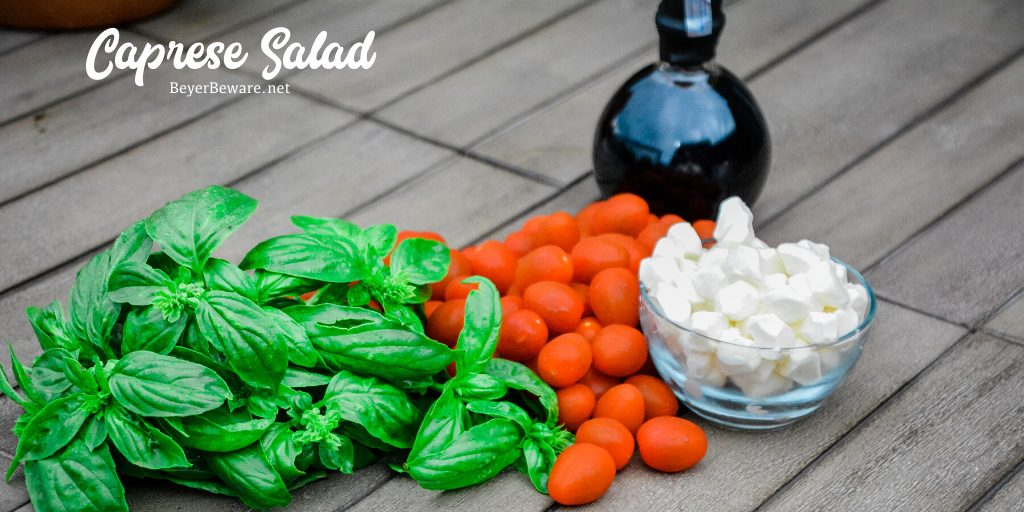 Caprese Salad Ingredients of fresh mozzarella cheese, tomatoes, basil, and balsamic vinegar