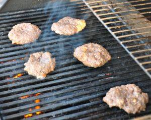 hamburger patties on the grill