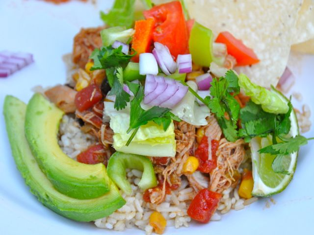 This easy Crock Pot Chicken Taco Bowls recipe that can feed a crowd and is gluten-free. This recipe will be your version of your favorite burrito bowl.