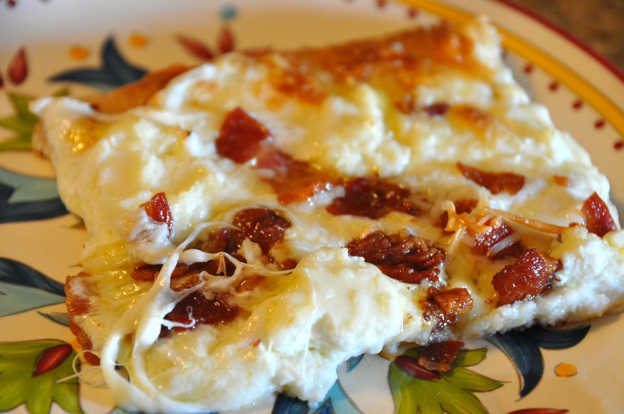 slice of cheese and bacon pizza