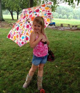 girl dancing in the rain