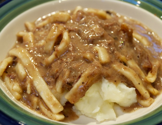 Beef and Noodles over mashed potatoes
